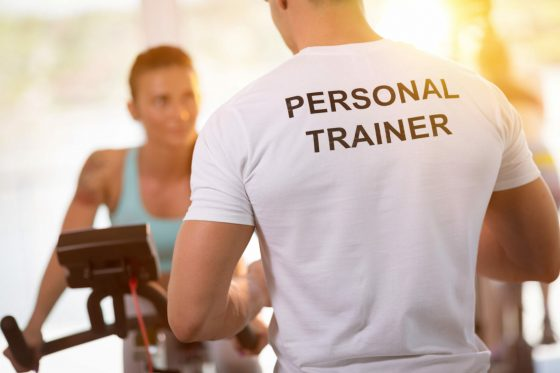 Personal,Trainer,On,Weights,Lifting,Training,With,Client